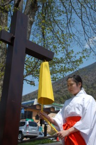 A Nikko <i>miko</i> and a yellow bell